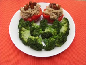 A picture of a dish with vegan stuffed peppers.