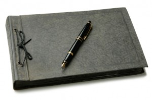 A guest book with a pen on top of it.