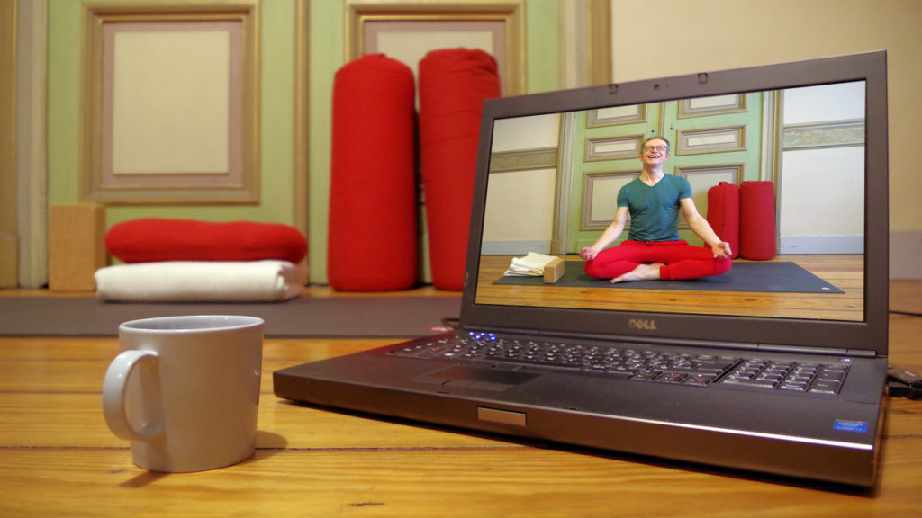 Picture of a live online yoga class on a pc
