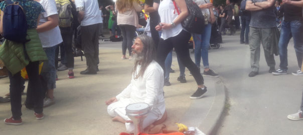 Picture of a peaceful yogi in a crowd.